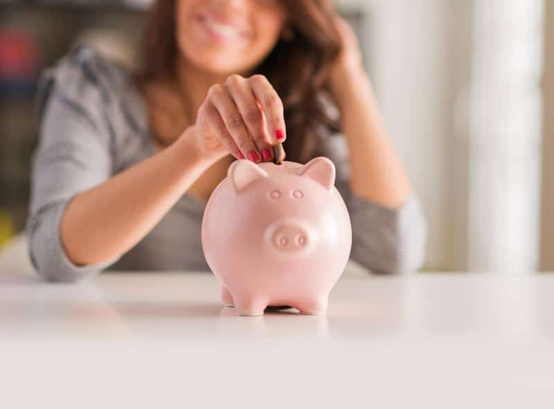 Woman saving money with a piggybank