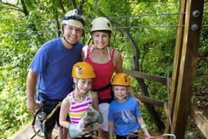 Happy family ziplining in the Smoky Mountains.