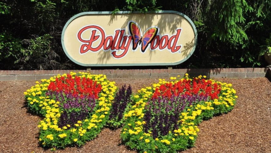 The sign and butterfly shaped flower display in front of Dollywood.