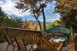 Chairs and a hot tub on the deck of the Heavenly View cabin in Gatlinburg.