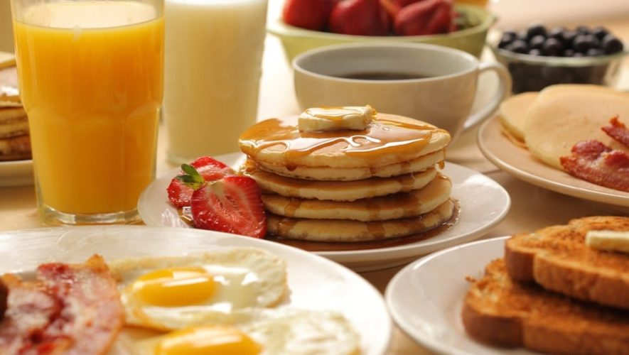 A variety of delicious breakfast foods on a table.